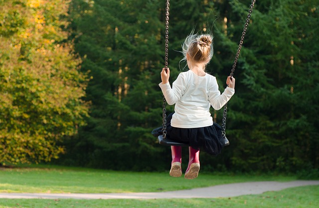 girl playing in a park